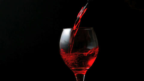 Glass of red wine being poured Stock Video Footage
