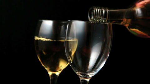 Two glasses of white wine being poured Footage