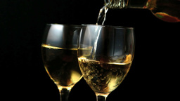 Two glasses of white wine being poured Stock Video Footage