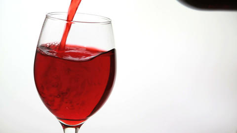 Glass being filled with red wine Stock Video Footage