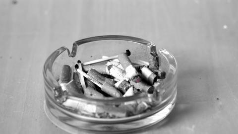 Cigarette falling in ashtray Footage