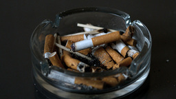 Cigarette Falling Into Ashtray stock footage