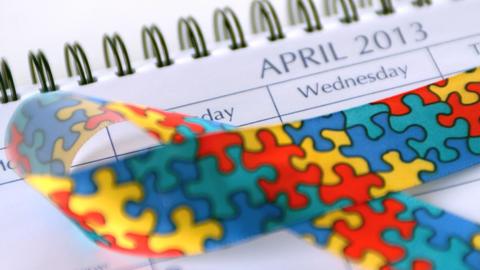 Awareness ribbon falling on calendar marking aware Footage