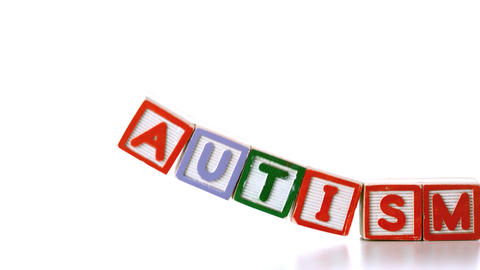 Autism letter blocks falling over Stock Video Footage