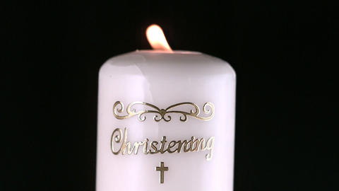 Lit christening candle flickering Stock Video Footage