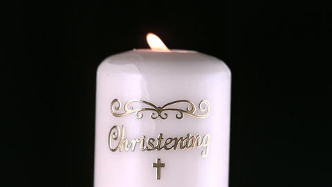 Lit christening candle flickering Footage