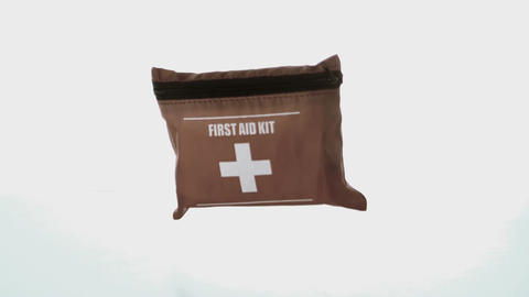 First aid kit falling on white background Stock Video Footage