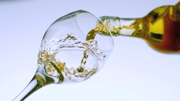 White wine pouring into a glass low angle view Stock Video Footage