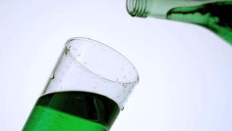 Green liquid pouring into glass Stock Video Footage