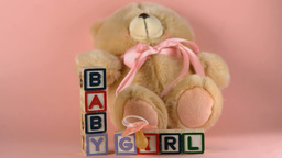 Teddy bear falling onto baby blocks and pink sooth Footage