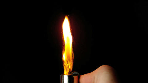 Hand lighting lighter with large flame and sparks Live Action