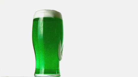 Pint of green beer overflowing Footage