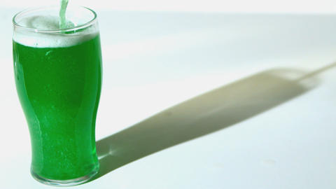 Green beer pouring into pint glass Stock Video Footage