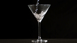 Water pouring into cocktail glass Footage