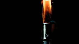 Hand using lighter on black background Stock Video Footage