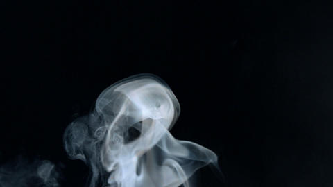 Puff of smoke rising Footage