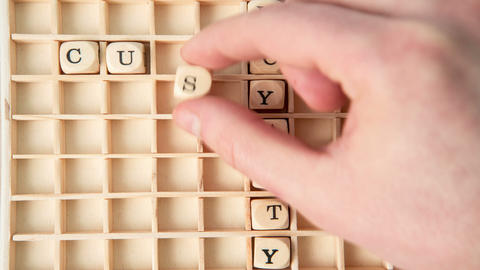 Customer care buzz words spelled out in dice and p Footage