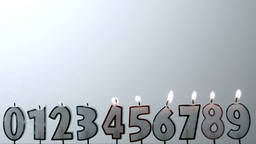 Number candles blowing out in numerical order with Footage