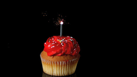 Sparkler burning on red birthday cupcake Stock Video Footage