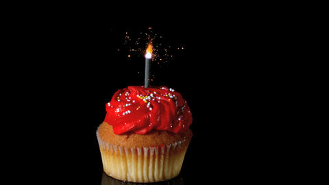Sparkler burning on red birthday cupcake Footage
