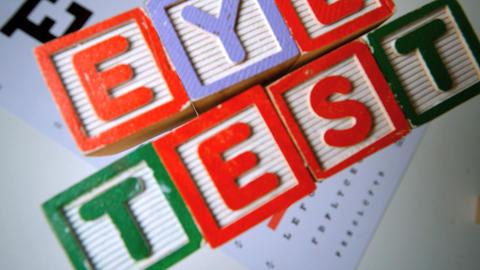Blocks spelling out eye test falling onto eye test Stock Video Footage