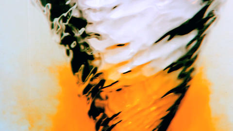 Water whirlpool with orange ink Footage
