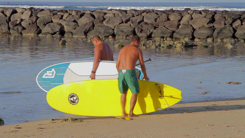 fit men preparing to head out to surf and waikiki Live Action