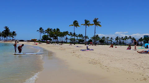 people hanging out at the waikiki beach Stock Video Footage