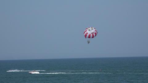 Balloon, parachute over the sea. 4K Footage