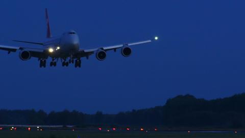 4K UHD Stock Footage Cargo Plane Landing At Dawn stock footage