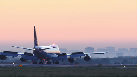 Stock footage Cargo Plane Taxiing Against City Daw Footage