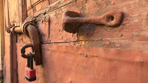 Iron bolt on a wooden door. 4K Footage