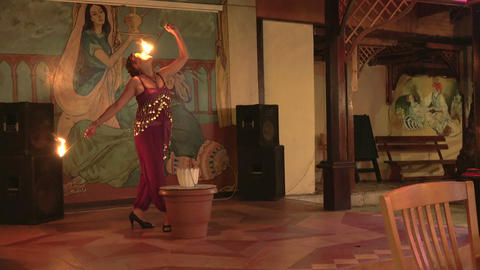 Woman dancing and swallows fire. 4K Stock Video Footage