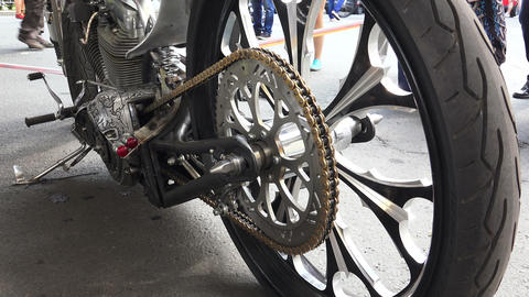 The asterisk at the rear wheel of the motorcycle Stock Video Footage