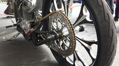 The Asterisk At The Rear Wheel Of The Motorcycle.  stock footage