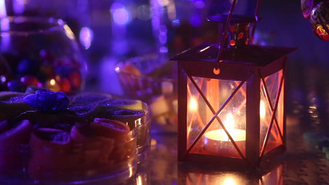 candle burning near a variety of sweets Footage