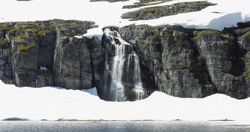 4K, Zoom on a waterfall, embedded in ice, Norway Stock Video Footage