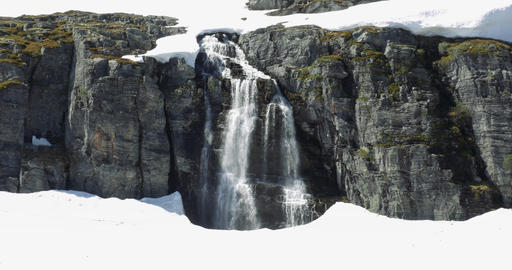 4K, Zoom on a waterfall, embedded in ice, Norway Footage