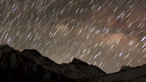 Time lapse of stars behind mountain Taboche, Chola Stock Video Footage