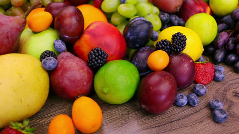 Different Berries and Fruits. Close-Up Footage