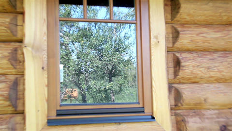 Reflection of trees in the log house glass wooden  Footage