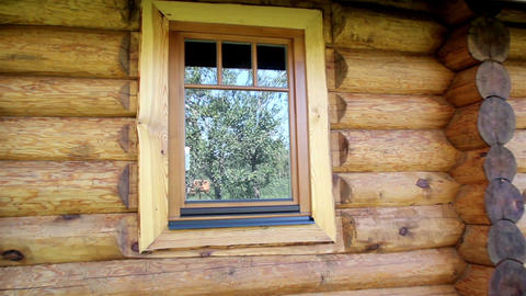 Reflection of trees in the log house glass wooden Stock Video Footage