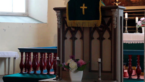 Church altar The pastor podium and a lighted candl Stock Video Footage