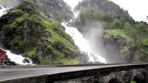 Bridge right under a beautiful water falls Footage