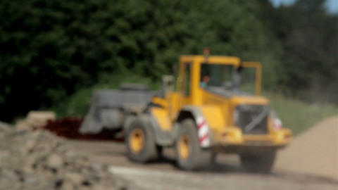 Bulldozer leaving site after transporting gravel a Footage