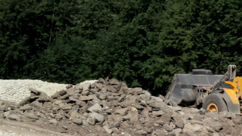 Bulldozer leaving site after transporting gravel a Stock Video Footage