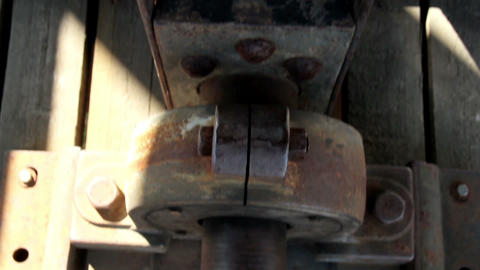 Closer image of the bolt and the rusty beam Stock Video Footage
