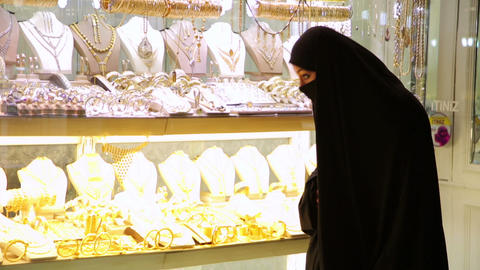 Steadycam - Woman with headscarf shopping at Grand Stock Video Footage