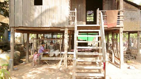 SILK ISLAND, CAMBODIA - MARCH 2014: woman silk man Footage