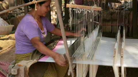 SILK ISLAND, CAMBODIA - MARCH 2014: woman silk man Footage